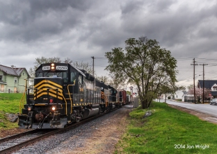 Heavy rains have inundated the region and passing south through Martinsburg, WV along Tuskegee Street is Train 86 on the former Cumberland Valley Railroad after interchanging with Norfolk Southern's Vardo Yard in Hagerstown, MD.
