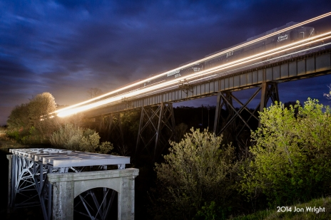OVERALL, VA - Along Route 340 between Front Royal and Luray, VA in the Shenandoah Valley at the Warren and Page County lines is a trestle where the former Shenandoah Valley, Norfolk and Western Valley Line crosses over Overall Run. Here at 5:30am NS 15T with an Illinois Central leader flies overhead. Lighting provided by Sean Hoyden.