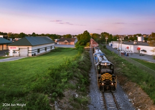 Train 86 passes through the northern parts of Martinsburg, WV in the last light of the day. The train has already interchanged with NS in Hagerstown, MD and switched some cars around at Berkeley Station Siding in order to make their CSX drop off in town a little easier.