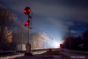 It's a very chilly 10 degrees at Shepherdstown, WV as 213 sits in the siding to meet the oncoming 12R. The venerable Norfolk and Western CPL signals stand guard both in the foreground and distance and have observed meetings like this many times since their initial installation on the H Line in 1923. Until the late 1950's, the lenses were all amber in color *much like the PRR PLS* but were converted to the color lenses you see today.
