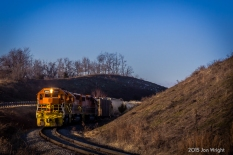 AROUND THE BEND: MMID 3450 3448 and 2601 push 20 empties hoppers to the Lehigh Portland Cement Plant alongside Shepherd's Mill Road an hour after sunrise.