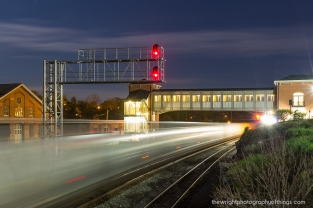 eastbound train passes by the roundhouse and station complex