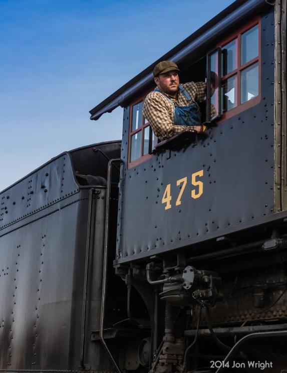 ALL CLEAR AHEAD: The Strasburg Railroad 475 engineer looks out ahead as the engine lurches forward toward the shop.
