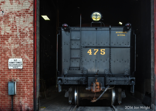 """RETIRING FOR THE DAY: SRC 475 and tender retire for the day to the shop building after pulling excursions this day as part of the railroads """"Bunny Trains."""""""
