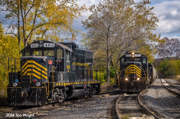 "The Winchester and Western ""Sandman"" with empty hoppers in tow, returns from it's namesake town back into Gore, a tiny hamlet in northwestern Virginia and since 1944, the western terminus of the railroad that once spanned through the thick forests' to Wardensville, WV."