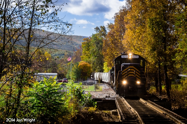 On original W&W trackage, power pushes about 30 empties west from Gore to the sand mine under peak fall foliage color. The Winchester & Western tracks originally ran another 20 some miles to Wardensville, VA but was cut at the sand mine in 1944 after traffic and timber resources declined.