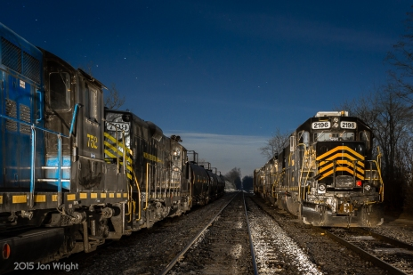 W&W NEW YEAR'S LULLABY: Holding down the fort during the 2015 New Year's holiday are an assortment of power in Corning Yard. On the left is GP9 403 (not pictured), GP10 752 and GP9 709. On the right are the newer GP38s 2196, 2689 and 2182 under a moonlit sky.