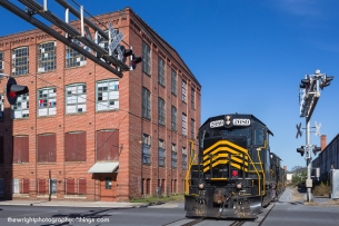 """For the past few years until very recently this shot has has not been possible due to schedule changes on the railroad but now they are back to their normal operating times. The Winchester and Western Hagerstown run, more affectionately known as """"86"""" returns with 75 cars thru downtown Martinsburg by the former Interwoven Mill facility on Sunday November 15, 2015"""
