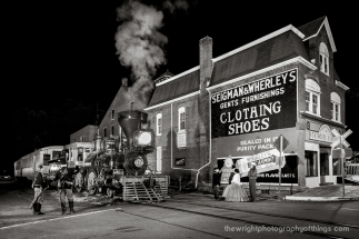 Disregard the modern street signs and the out of place Wrigley's ad and you can venture back to the American Civil War as a night passenger run rolls into Glen Rock, PA to pick up a few passengers as Union soldiers guard the train and her passengers. Part of the venture's second annual railfan day was this night charter with lighting provided by Steve Barry.
