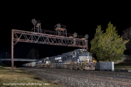 A loaded Norfolk Southern coal train 590 destined for the port of Baltimore passes under this classic Pennsylvania Railroad signal bridge at Summerhill, PA just after midnight on February 20, 2017.