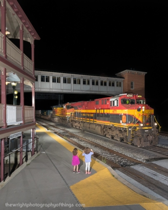 "My daughters wave to the oncoming train. Here is Q138 with Kansas City Southern ""Southern Belle"" 4771 at the front passing by the station in Martinsburg."