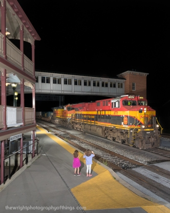 """My daughters wave to the oncoming train. Here is Q138 with Kansas City Southern """"Southern Belle"""" 4771 at the front passing by the station in Martinsburg."""