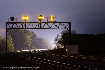 With a coal train stopped at CP GRAY. an eastbound intermodal approaches the PRR signals at Tipton, PA. Why was the coal train important? Because it was still in the block and kept the westbound signals lit.