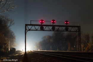 CANNON'S NIGHT LIGHTS: Standing guard on the former Pennsylvania Railroad Pittsburgh Line west of Harrisburg is this signal bridge at Duncannon. An eastbound approaches on track 2 as a westbound, on track 1 awaits to continue on and activates the position light signals.