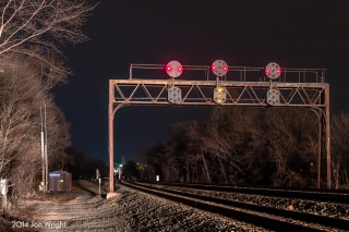 """YOU LIGHT UP MY NIGHT: A westbound rounds the curve and illuminates the PRR Signal bridge at Duncannon, PA as it enters the old PRR Middle Division to Altoona and Pittsburgh and other points west. The Top Head displays the """"snake Eyes"""" initally installed in the 1950's. The bottom head shows the clear indication but unknown to the eye, during this 17 second exposure, the signal was flashing."""
