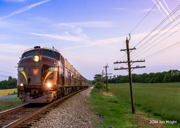 GOLDEN SLUMBERS: Returning from the Streamliner event in Spencer, NC are the Juniata Terminal restored PRR E8's and train pictured at sunset after crossing the Potomac River. The train will stop at Hagerstown before continuing its trip back home to Philly the next day.
