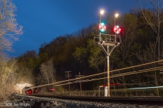PAW PAW, WV: The west portal of Carothers Tunnel sits in the distance and an east bound train streaks by in this long exposure taken in the roughly 2 minutes it took for the train to pass as you see it's end of train device flash.