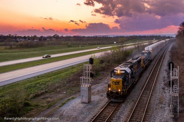 DUSK AT HOBBS: CSX Q216 reaches the summit of the upper Shenandoah Valley at Hobbs on the Cumberland Sub near Bardane, WV on March 28, 2012. Rain clouds loom in the distance as the sun had set over the horizon about ten minutes prior to the trains arrival. The train with CSX SD50 8575 leading runs alongside the West Virginia Route 9 Freeway for a few miles between Kearneysville and Shenandoah Junction. The bridge where this was taken is popular among local railfans as it currently only leads to an orchard the the highway separated when it was built and sees very little use.