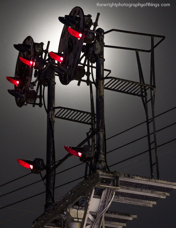 The lit signals at Berryville are set against a full moon.