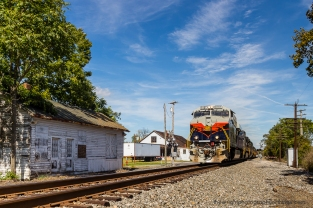 H48.4 CENTRAL OF GEORGIA: My first Norfolk Southern Heritage Unit I photographed in September, 2012 at White Post, VA. The building to the left is the 1940'same N&;W freight house.