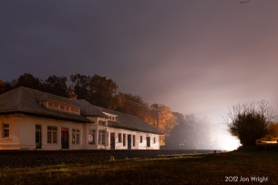 LADY IN WHITE: A northbound NS train disrupts the night approaching the Boyce, VA depot.