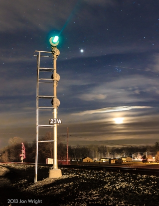 These NY style signals on the former Conrail Lurgan Branch stood until June of 2013. The Moon sets in the distance as an oncoming train approaches.