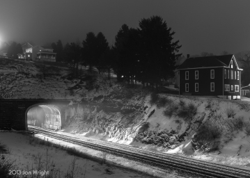 SNOW LIGHT: A westbound train is about to exit the Gallitzin Tunnel and lights up the inside liner, heavy moisture in the air and the blowing snow.