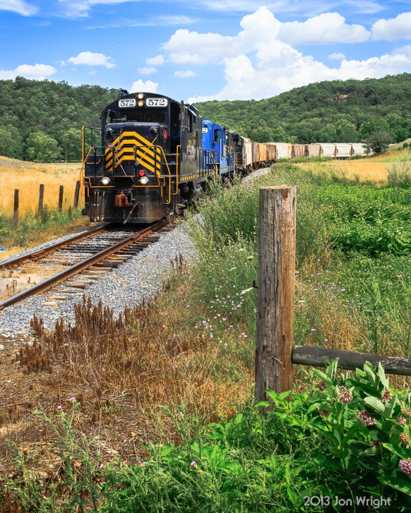"""Off Indian Hollow Road in western Frederick County, VA the W&W """"Sandman"""" begins its climb uphill out of the Hogue Creek Valley in it's journey towards Gainsboro at the top of the grade in July 2013. The segment of track from Winchester to Gore, VA is part of the original W&W grade built in and around 1917 that at one time extended all the way to Wardensville, WV and supplied wood for railroad ties for the Baltimore and Ohio."""