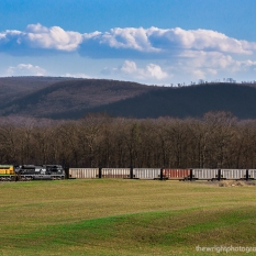 Spring is finally in the air and the NS READING unit on the former READING Lurgan Branch just north of Shippensburg, PA leads empty hoppers back to the Appalachian coal mines.