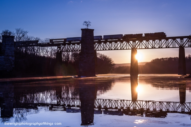 35Q moves high above the Potomac River on the Norfolk Southern H Line during a frigid winter sunrise.