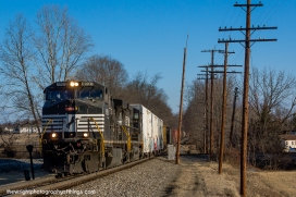 H28.0 35Q thunders over the NS/CSX diamond in Charles Town, WV on a frigid February morning in 2015.
