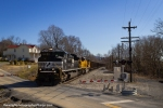 A new SD70ACE and old SD()MAC lead the empty hopper train 77 b y the tiny hamlet of Rileyville,VA.