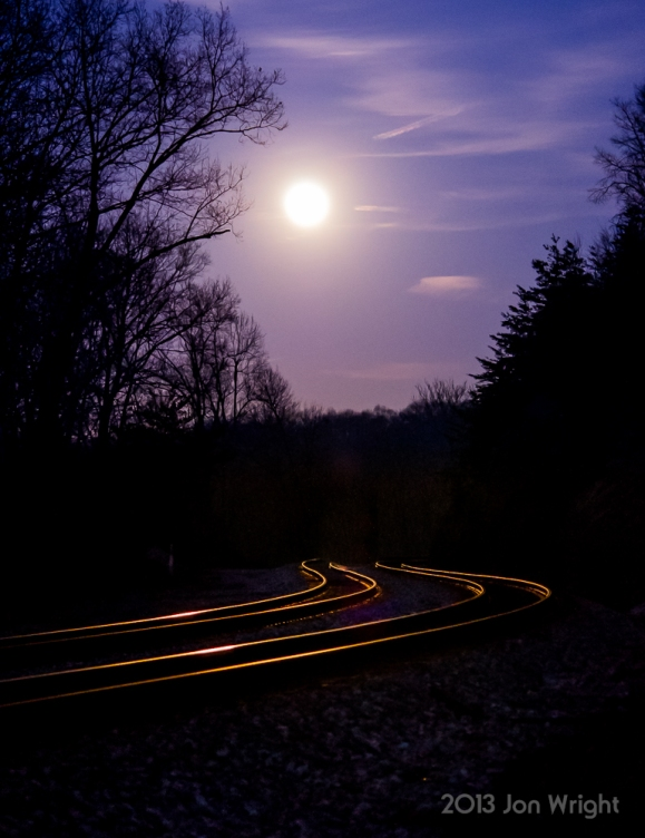 BEARDS ROAD CROSSING: A full moon rises over the tracks.