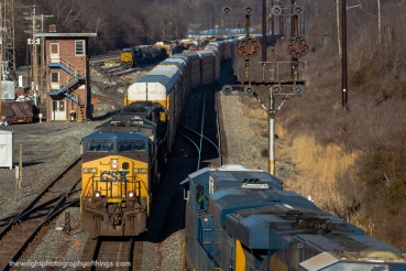 """A SCENE SOON TO CHANGE"" CSX Q216 passes by the closed Mexico Tower and the soon to be replaced B&O CPL signals as E705 patiently waits with a new crew to head westward."
