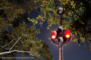 """The 'Charles Town Crossing' (Ranson) was historically operated and maintained by the N&W, who used Union Switch & Signal appliances (as opposed to B&O's """"General Railway Signal"""" wares. Long story short, these are probably the last surviving examples of US&S 'Color Position Light' signals in the USA (so, anywhere? - Washington Union Terminal Co. still had a few). They replaced lower-quadrant semaphore signals here as early as the 1920s"""