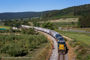 South Mountain looms in the background as CSX local D795 travels from Hanover, PA to Hagerstown, MD and drifts downgrade and into the Cumberland Valley on the former Western Maryland Railway mainline. Leading is CSX SD40-3 (affectionally known as Spongbob Squarecabs in the railfan community) 4084 a rebuilt Louisville & Nashville SD40-2 and formerly CSXT 8020. It was rebuilt in the CSX Huntington, WV shops earlier this year