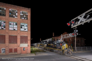 An almost daily occurrence when the Winchester and Western makes its run through town. This night was no different. Seen here at West John Street a couple hundred feet south of the CVRR station as the horn and roar of the engines brings traffic to a halt.