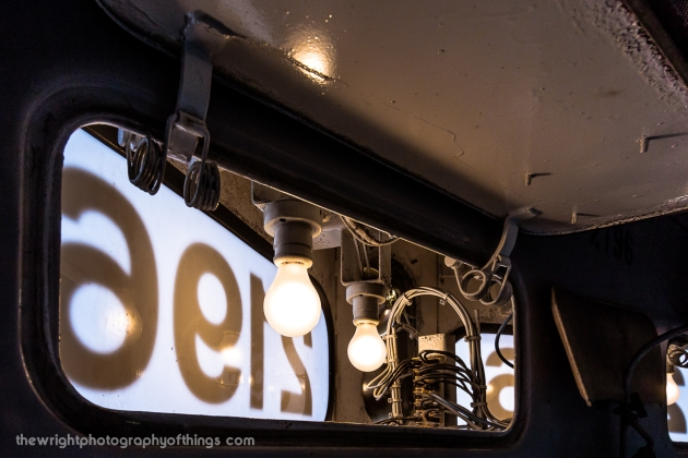 The interior look from inside the cab of the numberboard and headlight fixtures.