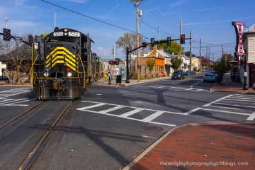 The locomotives have just passed the former B&O Station and WW Headquarters at the corner of Kent and Piccadilly Streets in downtown Winchester on the joint CSX/WW mainline on it's way to taking 28 empties back to Gore.