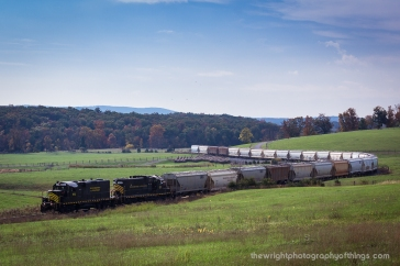 """With 28 empties in tow, the Winchester and Western """"Sandman"""" twists and turns on the original right of way as it climbs up Gainsboro Hill on it's trek to the base at Gore, VA. In July of 2016 the railroad celebrated it's 100th birthday of the company's charter. 2017 will mark the century mark for much of the mainline still in use today including this stretch between Winchester and Gore."""