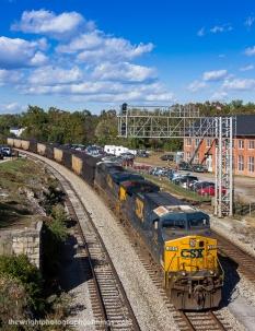 An eastbound coal drag passes thru martinsburg, WV. Shot from an open window on the seldom opened pedestrian bridge.