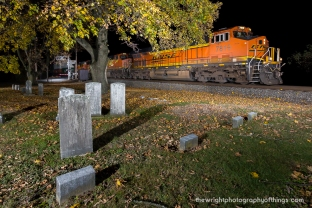 A trio of BNSF motors lead intemodal train 201 passes a local cemetery in Pennsylvania's Cumberland Valley near Shippensburg on the Norfolk Southern Lurgan Branch in Walnut Bottom.