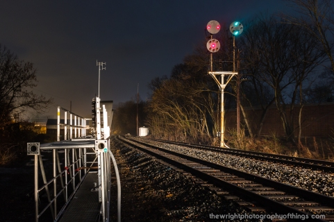 A northbound approaches the N&W signals at Shepherdstown as their replacements lay on the ground ready for installation as part of the PTC mandate.