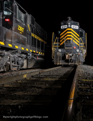 High hood GP9 498 basks in the light in Winchester and Western's Corning Yard. GP38 2197 rests on the adjacent track.