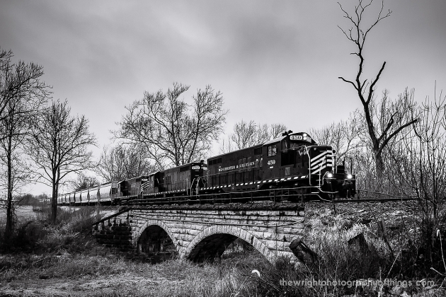 A southbound Winchester and Western train special from Hagerstown to Winchester crosses Mill Creek in Bunker Hill, WV on an original Cumberland Valley Railroad stone arch bridge that dates to the railroads construction in 1889.