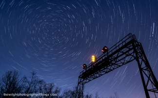 "Twenty-Seven and a half minutes elapse in this collection of four shots layered together as the Pennsy signal bridge at AR (Allegheny Range) stands tall against the backdrop of the swirling night sky and the North Star. This signal stands close to the Pennsylvania Railroad's summit across the Eastern Continental Divide 2,167 feet above sea level and lets eastbound crews know half the journey over the mountains is complete before they enter Portage Tunnel and into ""The Slide"" and down the mountain."