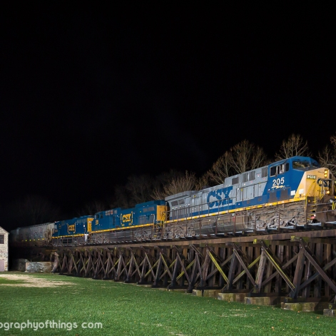 CSX D789 passes through Harpers Ferry's Lower Town across the 1850's wooden trestle built by the Winchester and Potomac Railroad. The train is taking 105 cars of wheat destined for Winchester, VA just after midnight on March 26, 2017. The structure was necessary to avoid the occasional high waters that rage through the confluence of the Shenandoah and Potomac Rivers. It was shortened at it's east end to rebuild the right of way in order to connect with the 1894 B&O bridge by using fill and a single deck bridge.