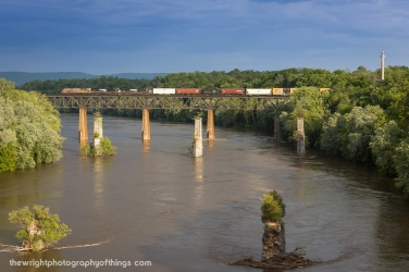 Gliding high across a very swollen Potomac River into Maryland is Norfolk Southern train 16T with the Delaware Lackawanna scheme heritage engine in the lead.