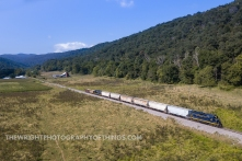 With the small community of Vanderlip behind them, the South Branch Valley RR runs along the bottom of High Apple Mountain as it approaches Romney, WV.
