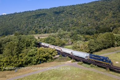 Making one of the many crossings of it's namesake, the South Branch Valley Railroad is seen over the Potomac near Romney, WV.